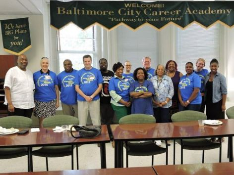 St. Ambrose and NHS of Baltimore volunteers with YouthWorks staff