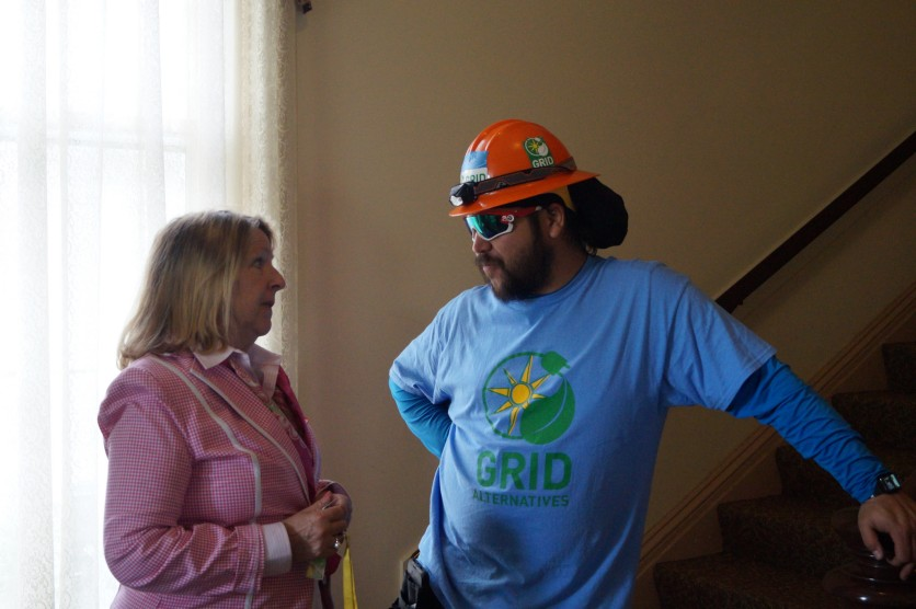Aigburth property manager, Mimi Kelly with GRID Alternatives project manager